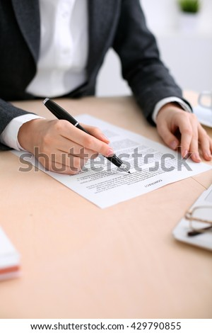 Business woman ready to sign a contract