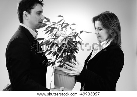 business woman receiving plant - stock photo