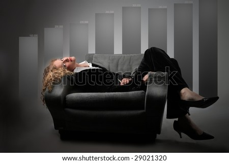 business woman relaxing on armchair against graph chart showing company's growth and success - stock photo