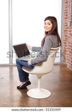 Business woman relaxing with her feet up on a laptop