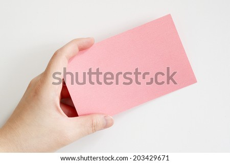 Business woman's hand holding a pink paper