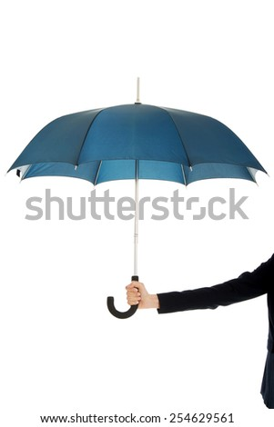 Business woman's hand is holding blue umbrella.