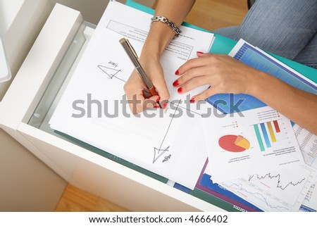 Business woman's hands and charts.