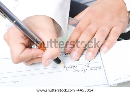 Business woman's hands and the pen.