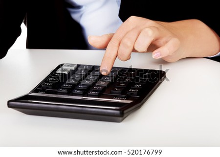 Business woman's hands counts on the calculator