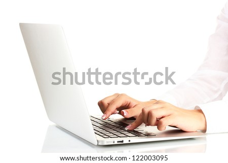 business woman's hands typing on laptop computer, on white background close-up - stock photo