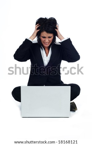 Business woman sat looking at the laptop and very angry