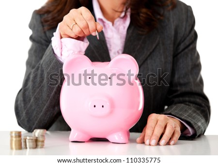 Business woman saving money in a piggybank - isolated - stock photo