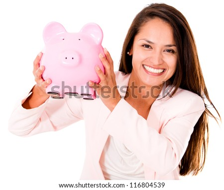 Business woman saving money in a piggybank - isolated over a white background - stock photo