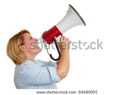 Business woman screaming loudly in a megaphone - stock photo