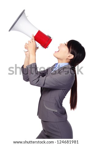 Business woman screaming loudly in a megaphone (face in profile) isolated on white background, model is a asian beauty - stock photo