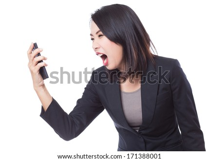 Business woman screaming or shouting at phone - stock photo