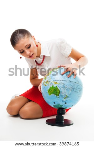 Business woman searching country on the globe,formal wear, isolated on white