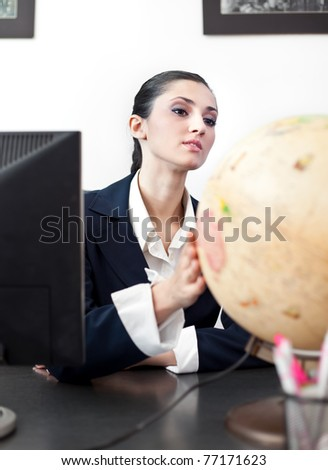 business woman searching new place on planet for her business - stock photo