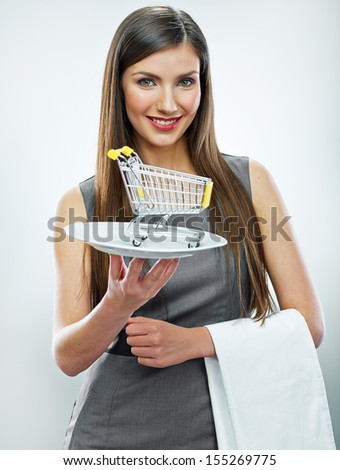 Business woman selling concept isolated portrait. Smiling girl hold shopping cart.