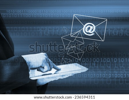 Business woman sending email by using digital tablet - stock photo