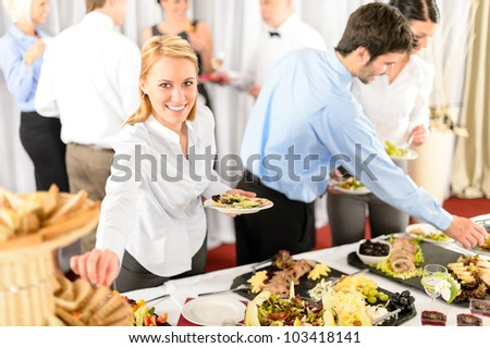 Business woman serve herself at buffet catering service company event - stock photo