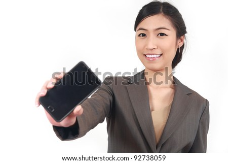 Business Woman Showing blank display of touch mobile cell phone (Focus on face smiling) - stock photo
