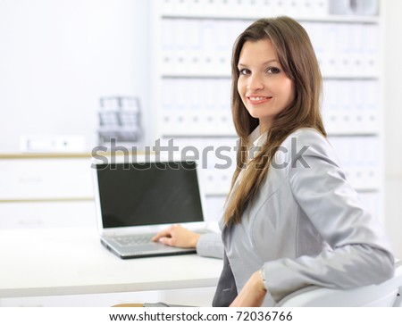 business woman showing blank laptop - stock photo