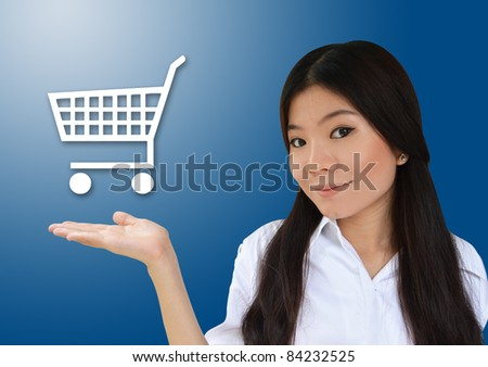 Business woman showing cart for e-commerce symbol - stock photo