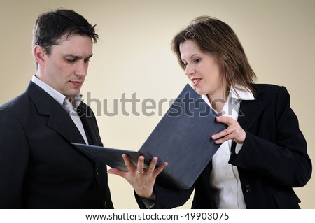 business woman showing contract to her manager - stock photo