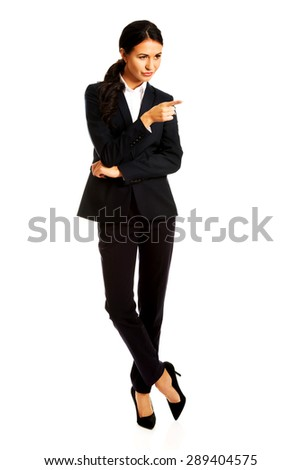 Business woman showing copy space on the right. - stock photo