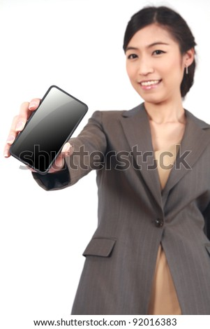 Business Woman Showing display of touch mobile cell phone (Focus on the hand and phone) - stock photo