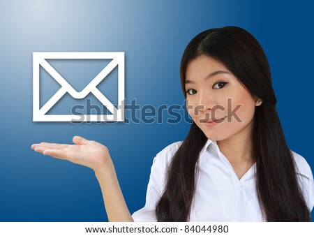 Business woman showing e-mail symbol - stock photo