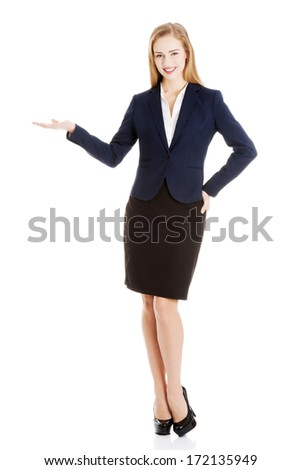 Business woman showing empty space on her palm and advertising. Isolated on white. - stock photo