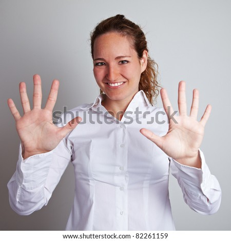 Business woman showing her open hands with ten fingers - stock photo