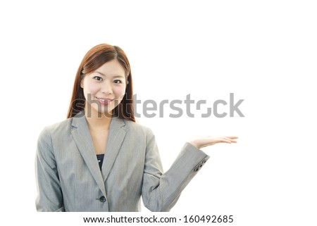 Business woman showing something on the palm of her hand