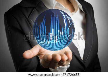 Business woman showing stock market candle graph analysis ball on hand palm. - stock photo