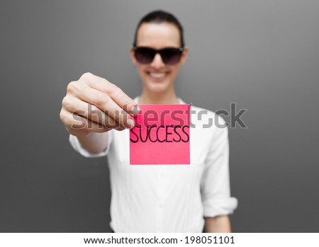 Business woman showing success sign to the camera. - stock photo