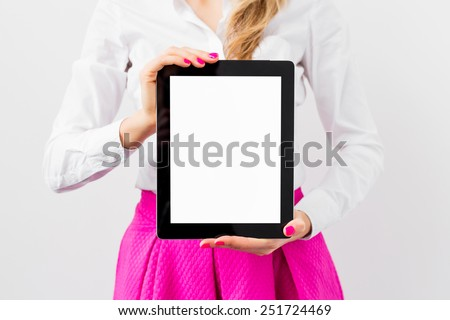Business woman showing tablet computer vertically - stock photo