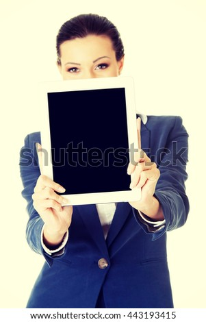 Business woman showing tablet PC