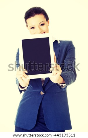 Business woman showing tablet PC with touch pad.
