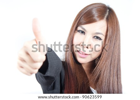 Business woman showing thumb up - stock photo