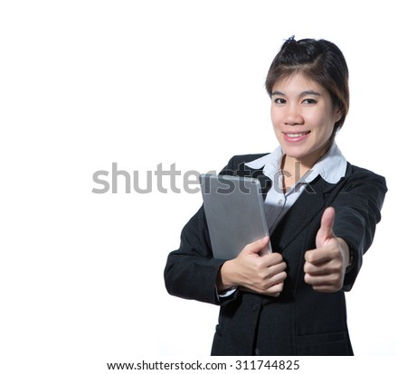 Business woman showing thumb up hand holding computer tablet , business concept of success with space for design