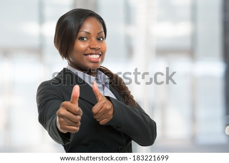 Business woman showing thumbs up - stock photo