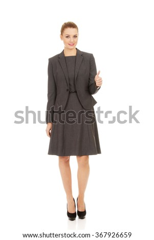 Business woman showing thumbs up. - stock photo