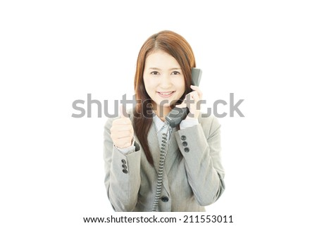 Business woman showing thumbs up sign - stock photo