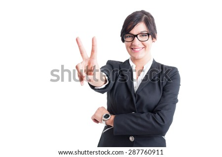 Business woman showing victory sign or number two with fingers - stock photo