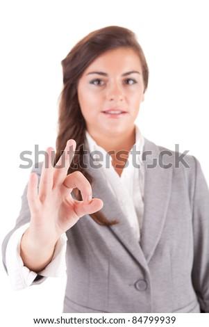 Business woman signalling ok, selective focus on hand - stock photo