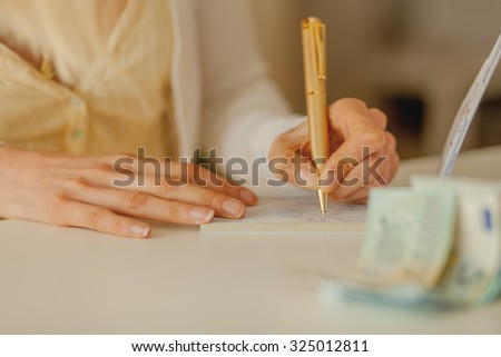 Business woman Signing a cheque  - stock photo