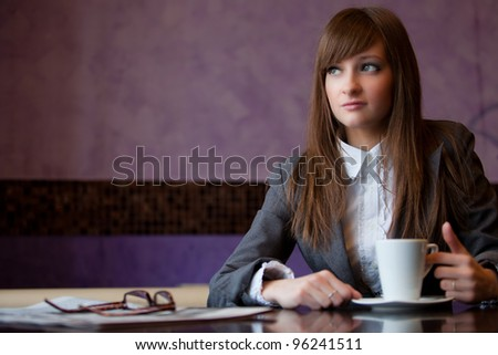 business woman sit in cafe