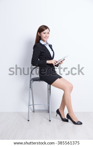 business woman sit with digital tablet pc computer with white wall background, great for your design or text, asian beauty - stock photo