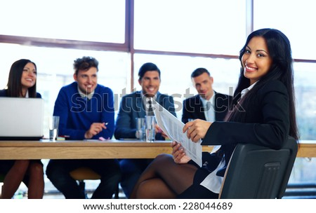 Business woman sitting at interview in office