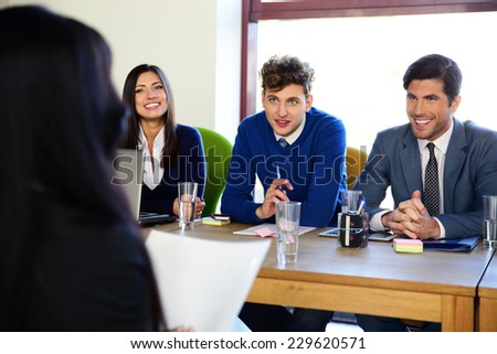 Business woman sitting at interview in office - stock photo