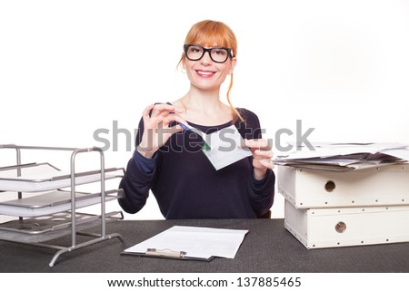 business woman sitting her desk getting rid of old papers - stock photo