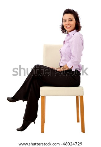 Business woman sitting in a chair isolated on white
